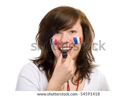 young female french team fan, with whistle and small flags on her cheeks, studio shoot isolated on white