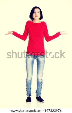 Young female gesturing do not know sign - stock photo
