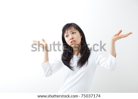 young female gesturing do not know sign against white background - stock photo