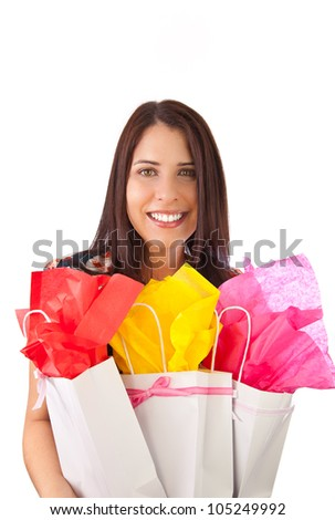 young female girl holding gift bags in her arms, isolated on white - stock photo