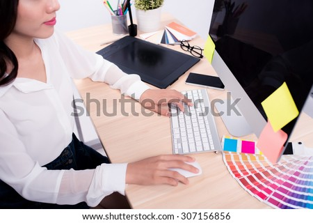 Young female graphic designer at work. Creative concept - stock photo