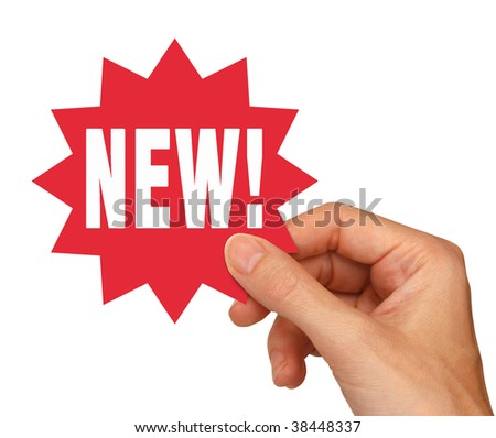 young female hand holding a red new sticker for use on internet shopping web pages. Isolated on white includes clipping path. - stock photo