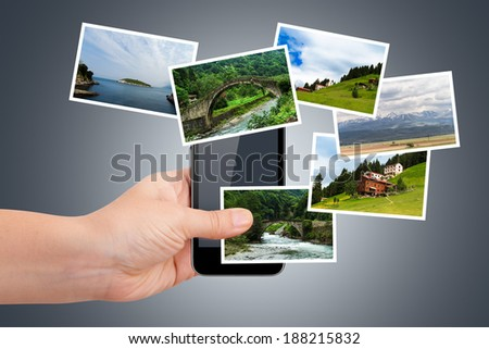 Young female hand holding smart phone and showing natural art photography or pictures on virtual area.