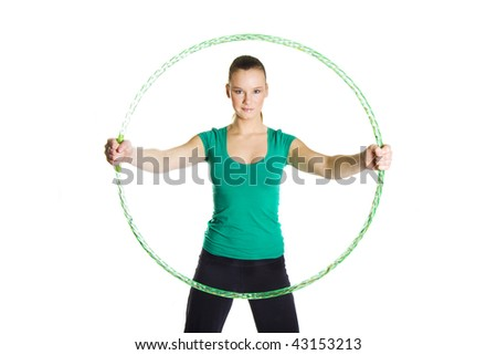 Young female holding a hula hoop isolated over white