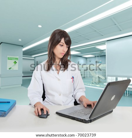 Young female hospital administrative in a desk at the hospital hall - stock photo
