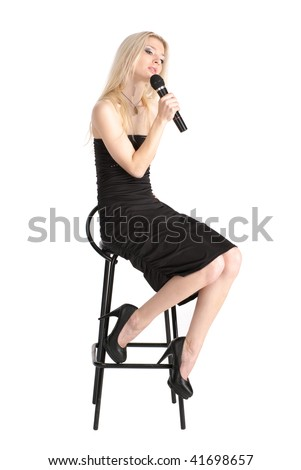 Young female in the black dress singing, over white - stock photo