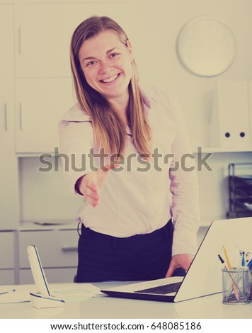 Young female manager ready to receive clients in her office