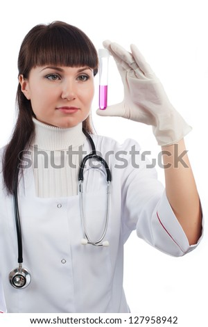 Young female medical scientist working with liquids - stock photo