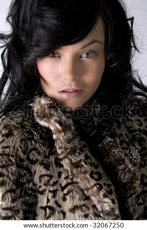 Young female model in coat
