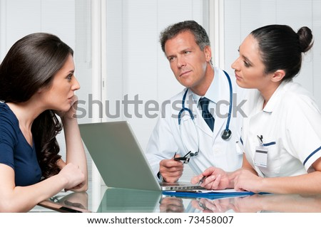 Young female patient discuss with doctors on her medical exam at hospital - stock photo
