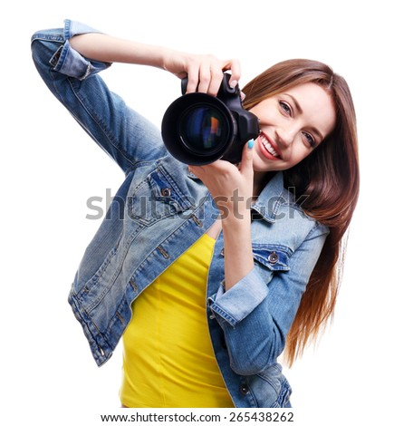 Young female photographer taking photos isolated on white - stock photo