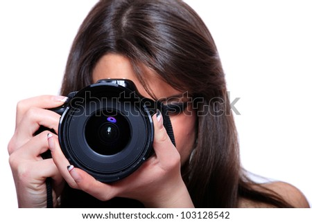 Young female photographer taking pictures - stock photo