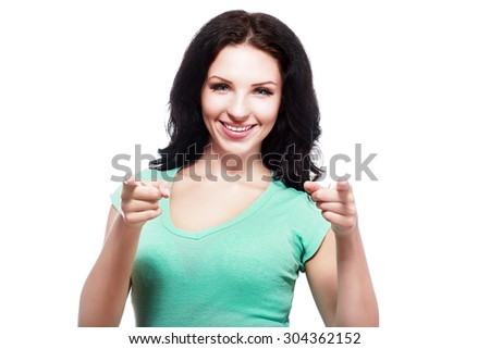 Young female pointing at you - Portrait of an attractive young woman pointing her finger. Isolated on white background - stock photo