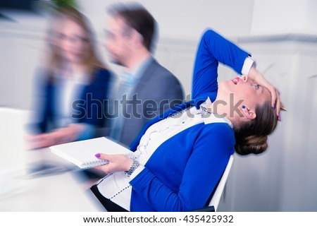 Young female professional does not agree with the opinion of her colleagues on a business meeting - stock photo