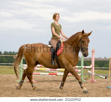 Young female riding on horse - stock photo