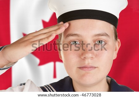young female sailor saluting in front of canadian flag - stock photo