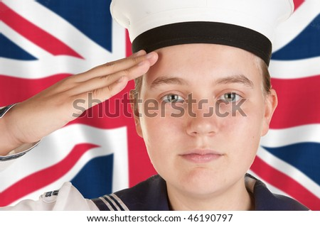 young female sailor saluting in front the union jack - stock photo