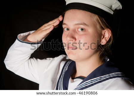 young female sailor saluting isolated on black - stock photo