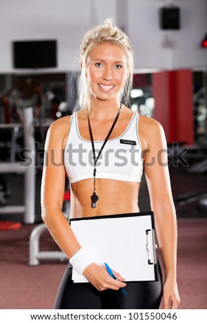young female school sport coach - stock photo