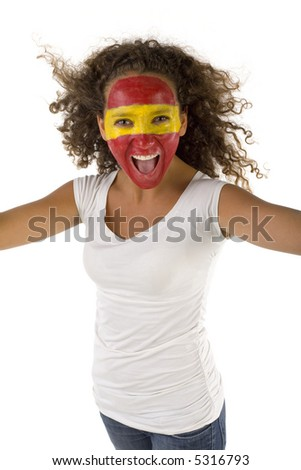 Young female screaming Spanish fan with painted flag on face. She's on white background. Front view. She's looking at camera. - stock photo