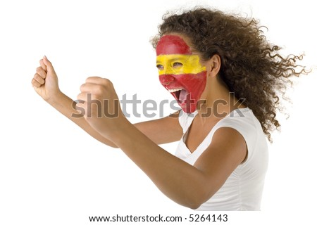 Young female screaming Spanish fan with painted flag on faces. She's on white background. Side view. - stock photo