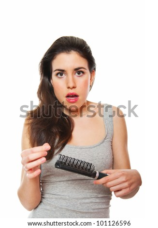 Young female shocked against hair loss - stock photo