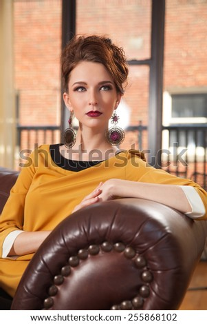 young female sitting with retro 1960's look  - stock photo