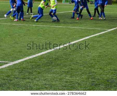 Young female soccer players - European football - blurred image - stock photo