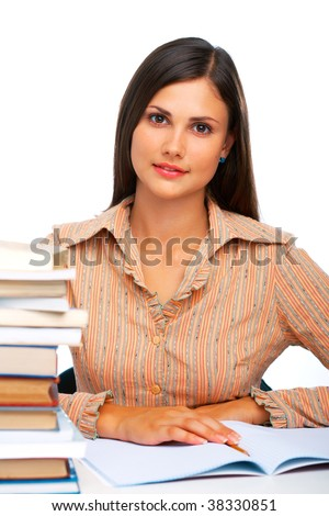 Young female student against light blue background - stock photo
