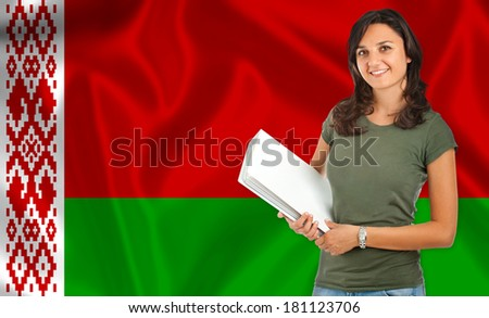 Young female student smiling over Belarusian flag