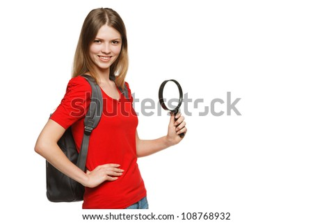 Young female student standing with magnifying glass, isolated on white background - stock photo