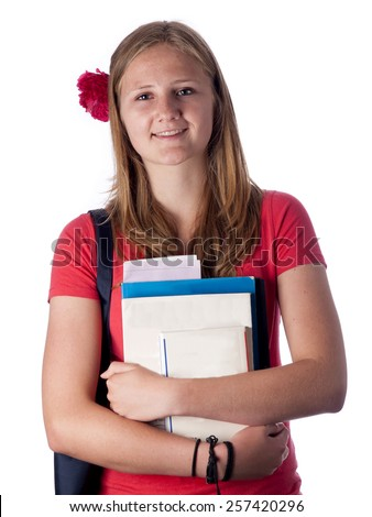Young female teenage student carrying books over a white background - stock photo