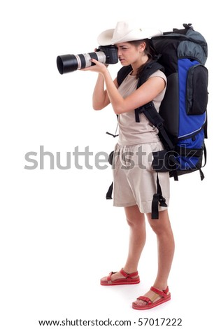 young female tourist with backpack and digital camera