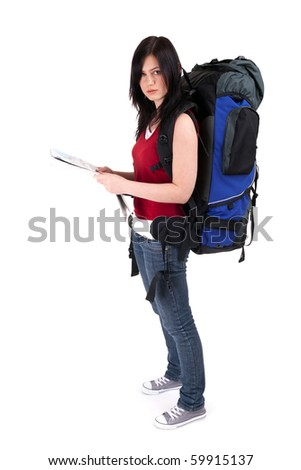young female tourist with backpack and map - stock photo