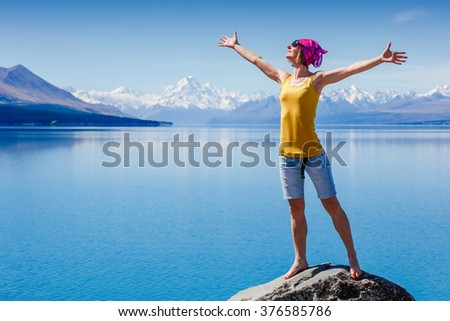 young female traveler enjoy the travel. adventure, travel, tourism, hike and people concept. New Zealand - stock photo