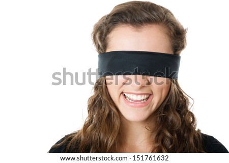 young female with black blindfold laughing closeup isolated on white - stock photo