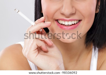 Young female with cigarette - stock photo