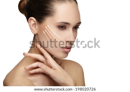 Young female with clean fresh skin, white background. - stock photo