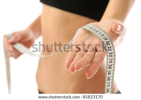 Young female with measure tape isolated. selective focus