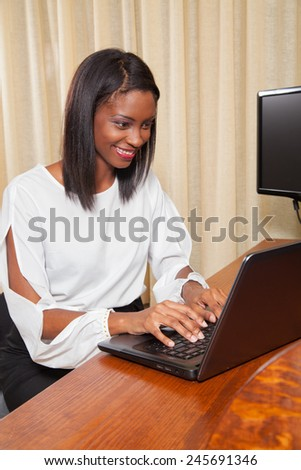 Young Female working on her laptop  - stock photo