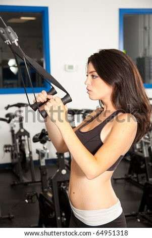 young female working out in gym - stock photo
