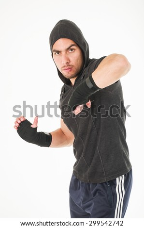 young fighter man wearing black hoodie attacking with elbow isolated over white