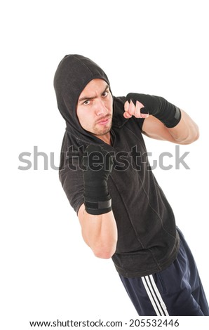 young fighter man wearing black hoodie ready to fight isolated over white