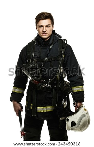 Young firefighter with helmet and axe isolated on white  - stock photo
