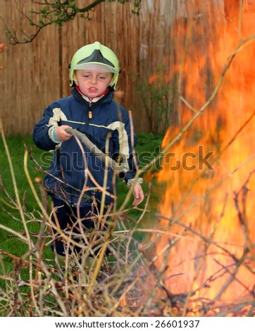 Young fireman in action - stock photo