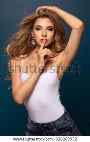 stock-photo-young-fit-and-sexy-woman-in-jeans-326269952