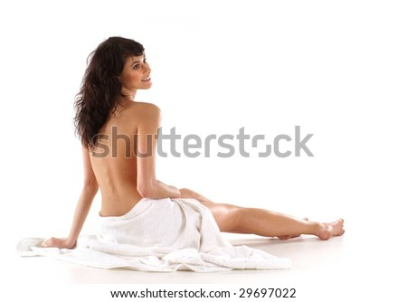 Young fit brunette relaxing isolated on white