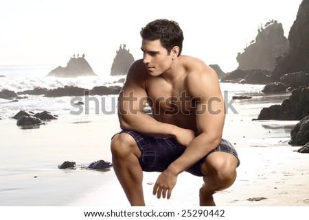 Young, fit good looking shirtless man on the beach - stock photo