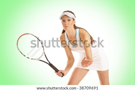 Young fit tennis player over green background - stock photo