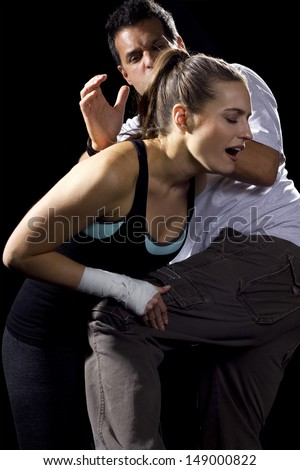 young fit woman fighting a man - stock photo